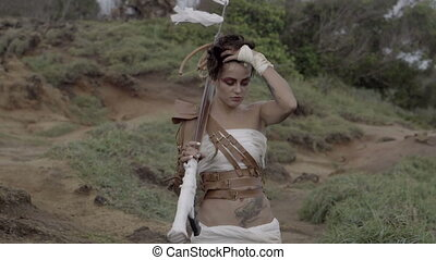Beautiful amazon woman warrior wearing white outfit and...