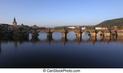 Aerial shot of Charles Bridge over Vltava river in Prague