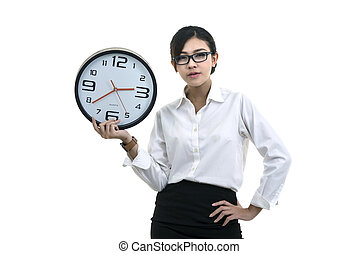 Smiling woman in glasses holding big clock