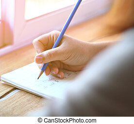 Woman writing on notebook,handwriting