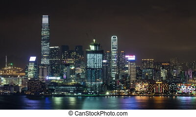 Timelapse of Hong Kong illuminated at night - Timelapse shot...