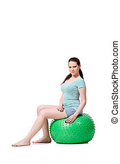 Young woman in sports concept isolated on the white
