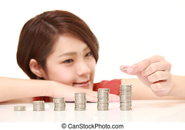 Increase of profits - studio shot of young Japanese woman on...