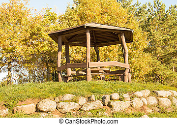 Wooden arbour on the hill - Wooden arbour among the trees in...