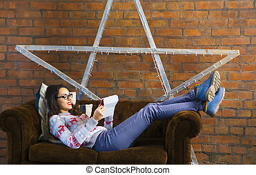 Woman lying on sofa with tablet pc