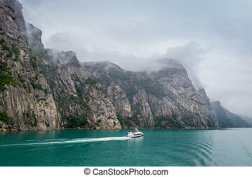 Norwegian Lysefjord view with small ferry. - Norwegian...
