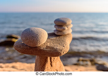 Stones on coast - Balancing some of stones on the seashore