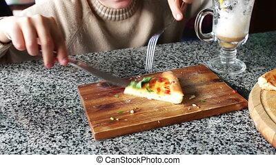 Boy Eating tasty Pizza - child eating fresh tasty hot pizza...