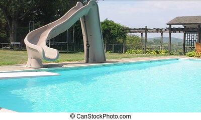estate swimming pool with water slide and pool house