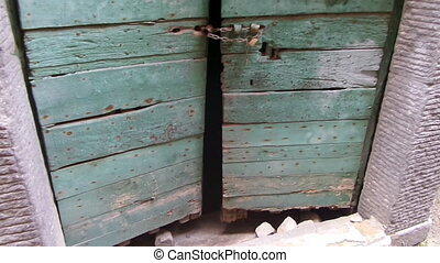 Old Cellar Door - Old cellar door in wood locked with chain...