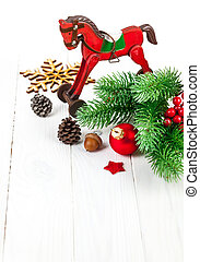 Christmas decoration with fir and pinecone on white wooden...