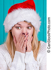 Christmas time. Young woman wearing santa claus hat red...