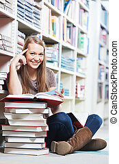 young female student sitting with book in library