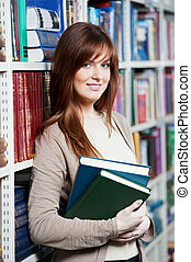 young female adult student with book in library