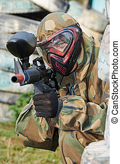 paintball player with marker - Adrenalin paintball player in...