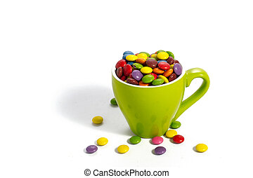 dragees in small green cup - Colorful dragees in small green...