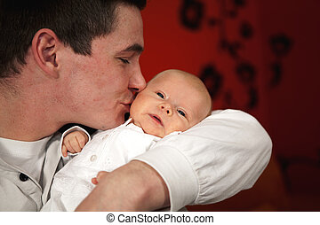 father kissing daughter - A happy and proud young father...