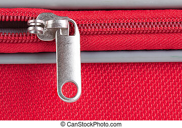 Half open - Closeup image from a zipper of a red suitcase...