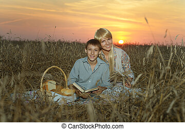 Mom and son in the field