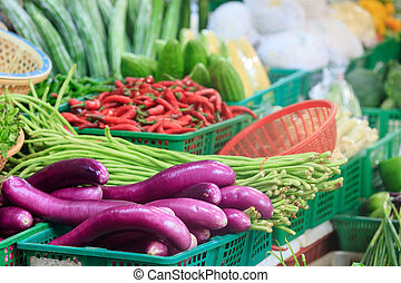 Traditional asian market - colorful vegetables sold on...