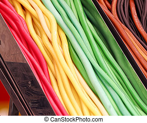 Colored candies; Wine gum in close up; Sweets at funfair;...