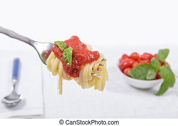 Spaghetti with Tomato Italian Sauce - Spaghetti on fork with...