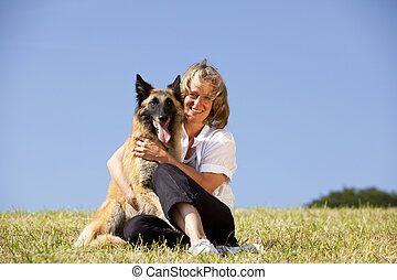 smiling woman with her dog - a happy beautiful smiling woman...