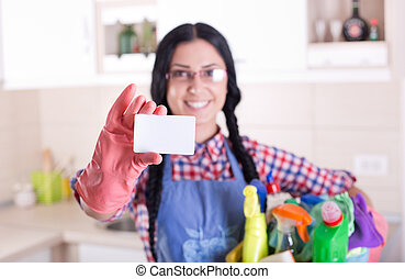 Cleaning lady showing businesscard - Smiling young woman...
