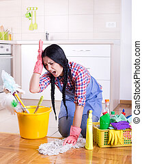 Frustrated cleaning lady - Frustrated young woman wiping...