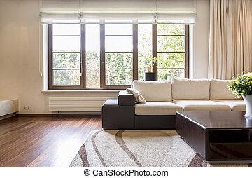 Cozy cream living room in new apartment