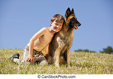 smiling boy with his dog - A smiling cute eight years old...