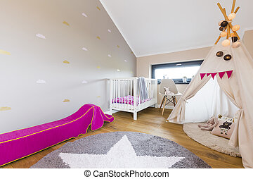 Modern baby room design with Indian tent