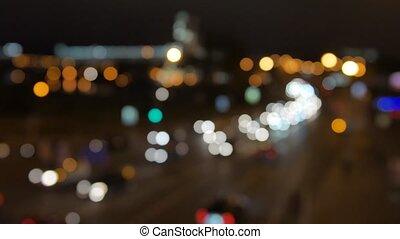 blur background. Moving bokeh circles of night traffic....