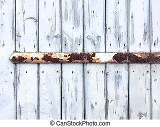 Old door hinge. - Old door with rusty door hinge.