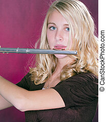 Flute Player Isolated on Pink - A blond blue eyed teenage...