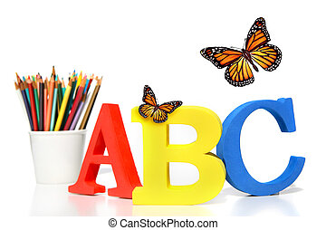 ABC letters with pencils on white background