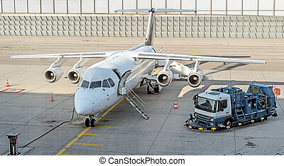 Commercial passenger plane in the airport. Aircraft maintenance.