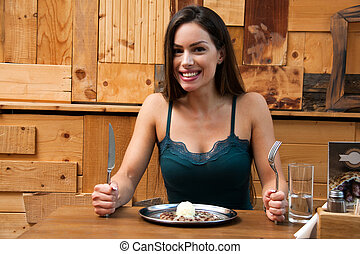 Beautiful woman eating meal