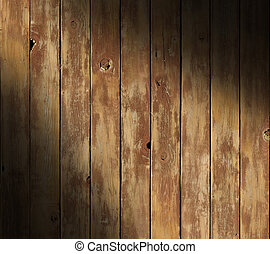 Distressed wooden surface diagonally lit
