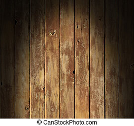 Distressed wooden surface lit dramatically