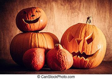 Halloween pumpkins, carved jack-o-lantern. Wooden...