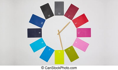 Clock of twelve colored monthly diaries, seamless loop...