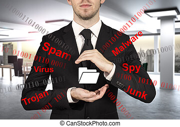businessman in office protecting file folder spam malware -...