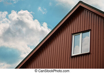 Attic with a small window - The brown attic with a small...