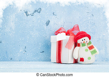 Christmas background with gift box and snowman