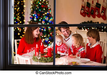 Family at Christmas dinner at home - Big family with three...