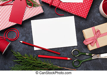 Christmas gift wrapping and blank greeting card. Top view...