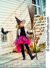 witchcraft girl - Pretty little girl in a costume of witch...