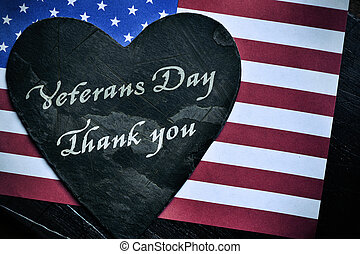 text veterans day, thank you and the flag of the US