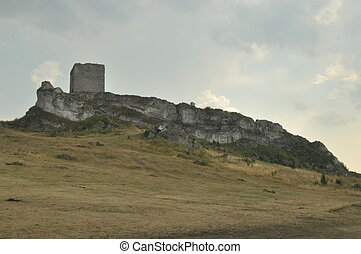 Castle in Olsztyn. Poland. Walls, towers and the ruins of...